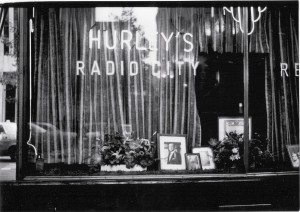 """HURLEYS – Hurley's was a long time entertainment watering hole of old New York, favored by """"NBC inmates,"""" as an Associated Press television writer wrote. It closed October 12, 1975. Its last night was covered by the """"Tomorrow Show"""" with Tom Snyder. In its window was an old photo of Jack Paar, the famed early """"Tonight Show"""" host. Paar wrote: """"When the boys in the band ask who this is, it's time to send them back upstairs!""""  The AP reporter noted that the occasion at the time of the writing """"already had the troops from NBC and elsewhere in profound grief."""" (Photo credit: NBC Press & Publicity Department, 1975). The closing of Hurley's as covered by the Tomorrow Show, was the author's first assignment as a television publicist. He was asked that week to join colleague Les Slater as a publicist on the then-new """"Saturday Night Live"""" in its second week after the premiere show hosted by George Carlin."""